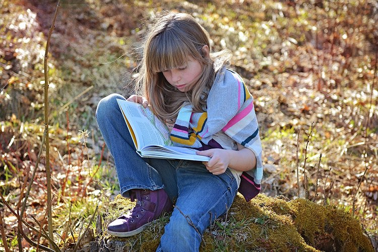 young person reading a book